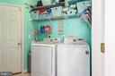 Large laundry room with custom shelves off garage - 28 FIREBERRY BLVD, STAFFORD