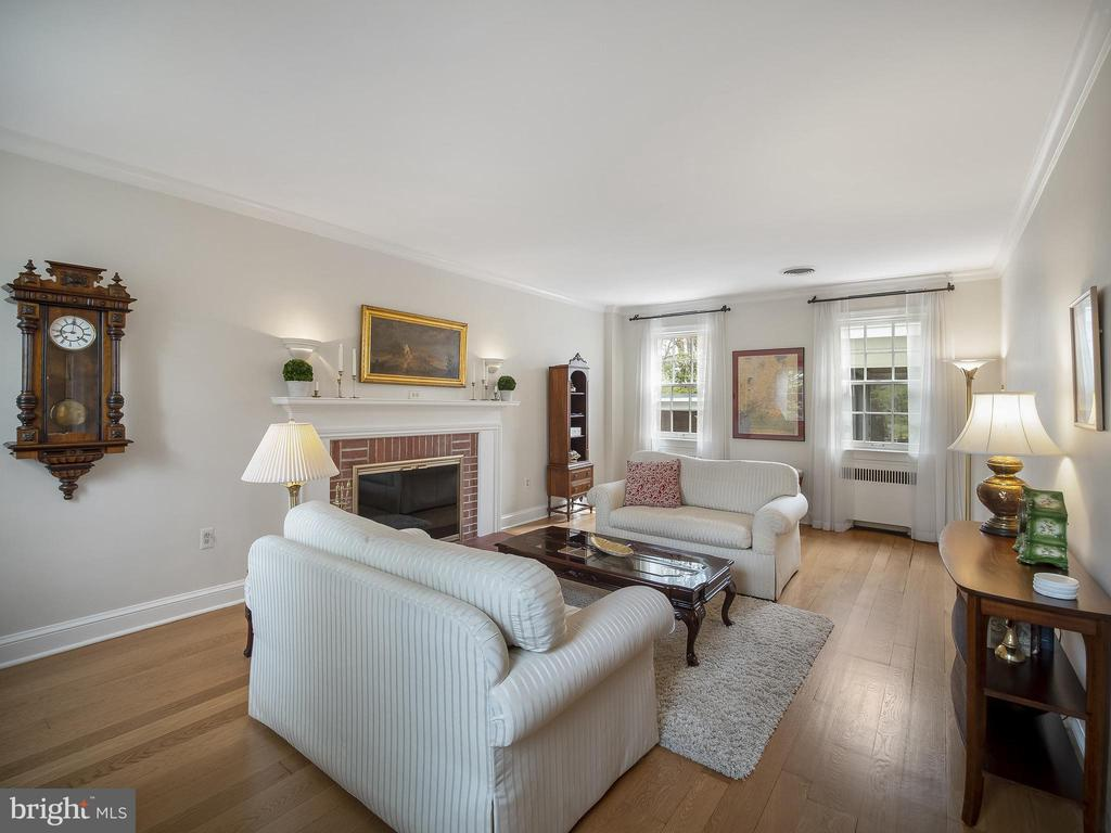 Formal living room with gas fireplace - 915 MCCENEY AVE, SILVER SPRING