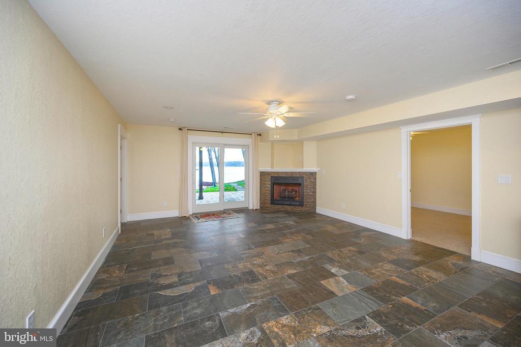 Family room w/ water view & corner gas fireplace - 123 MT VERNON CT, LOCUST GROVE