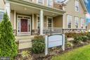 The Kingston shown with optional front porch - 307 NICHOLAS HALL ST, NEW MARKET