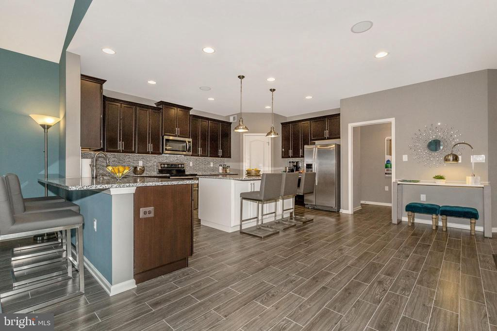 Kitchen shown with included island - 307 NICHOLAS HALL ST, NEW MARKET