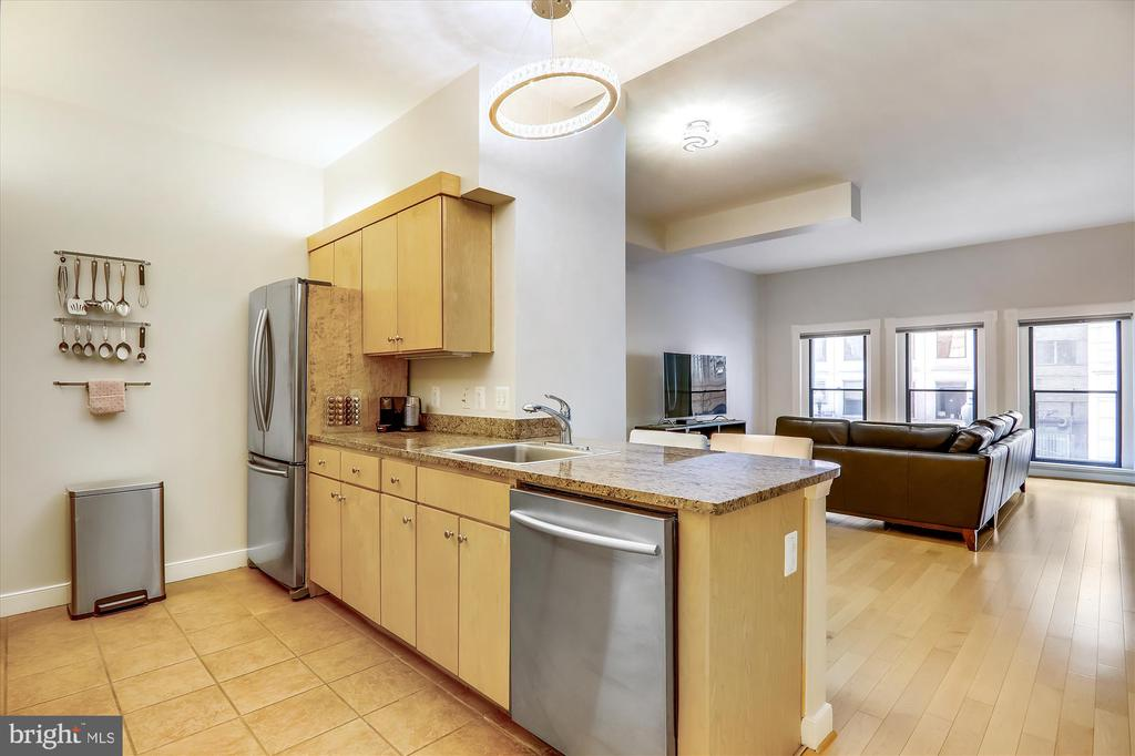 Kitchen with granite counters - 631 D ST NW #129, WASHINGTON