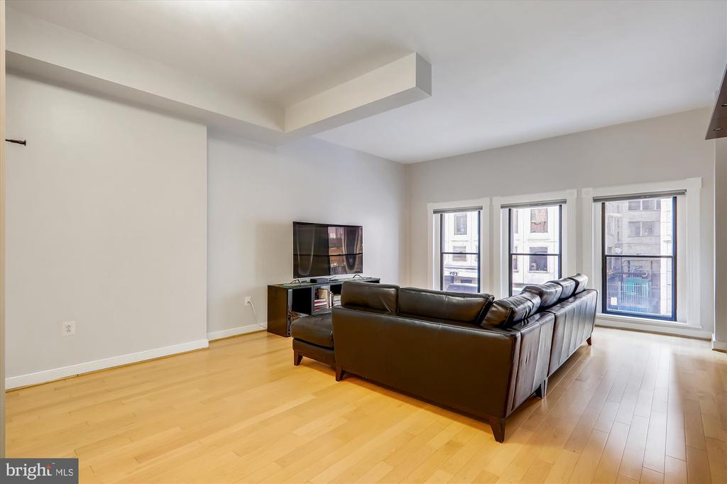 Living area with oversize windows - 631 D ST NW #129, WASHINGTON