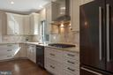 Gas range with custom stainless steel hood - 1696 BEECH LN, ANNAPOLIS