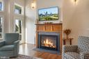 Gas fireplace features a hand-made teak mantel - 1696 BEECH LN, ANNAPOLIS