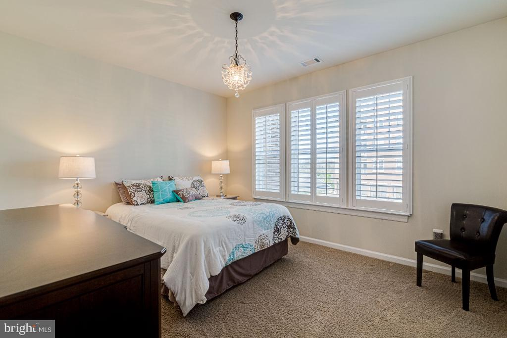 Good size secondary bedroom w/plantation shutters. - 20570 HOPE SPRING TER #205, ASHBURN