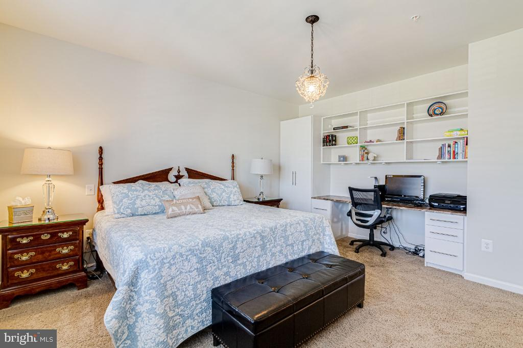 Master bedroom with beautiful buuilt-ins. - 20570 HOPE SPRING TER #205, ASHBURN