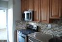 Updated Kitchen with W/D - 5500 HOLMES RUN PKWY #1517, ALEXANDRIA