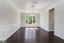 large formal dining room with new chandelier - 43965 RIVERPOINT DR, LEESBURG