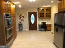 Kitchen opens to breakfast room, dining room - 4917 MUSSETTER RD, IJAMSVILLE