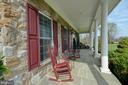 Flagstone front porch welcomes your guest - 40319 CHARLES TOWN PIKE, HAMILTON