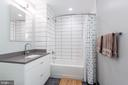 Guest Bathroom with Porcelain tile floor. - 1300 4TH ST SE #808, WASHINGTON