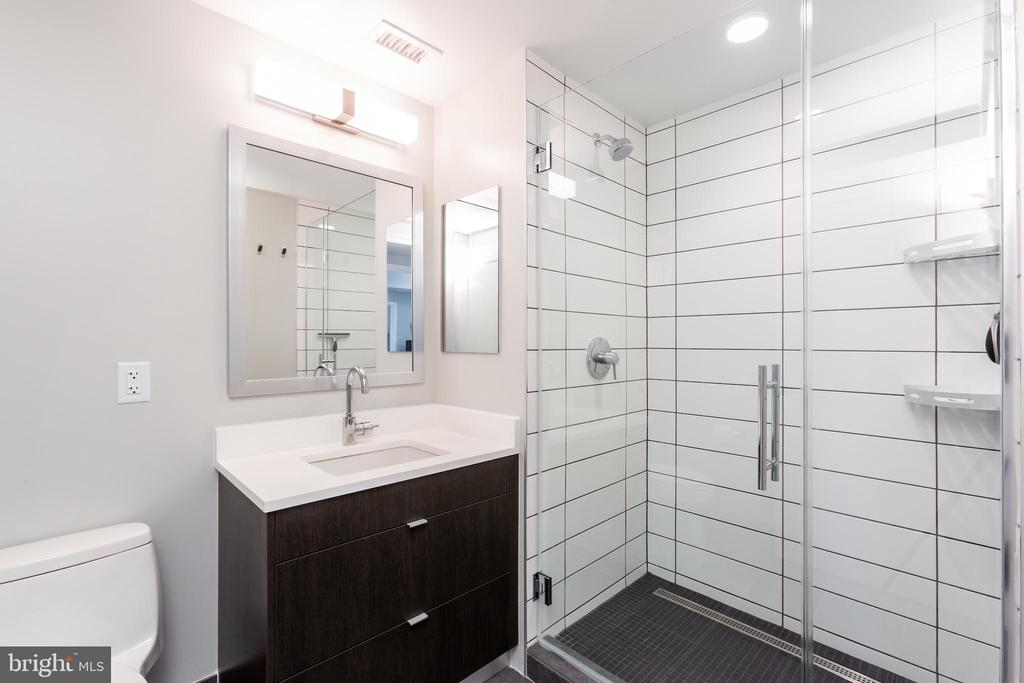 Master Bathroom with Frameless glass door. - 1300 4TH ST SE #808, WASHINGTON