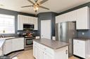 Kitchen features corian countertops - 770 CRUSHED APPLE DR, MARTINSBURG