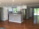 Kitchen opens to den-office area - 652 ALABAMA DR, HERNDON