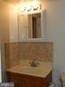 Bathroom with Bedroom and Hall Entrance - 136 DUVALL LN #304, GAITHERSBURG