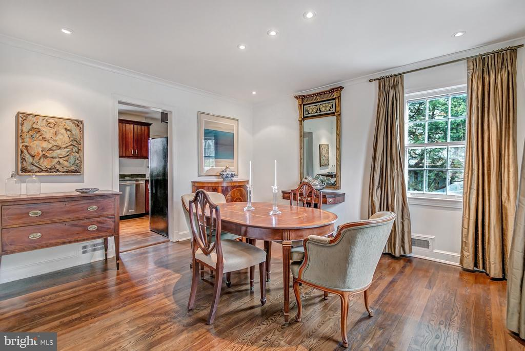 The dining room is to the right of the front hall - 7007 CONNECTICUT AVE, CHEVY CHASE