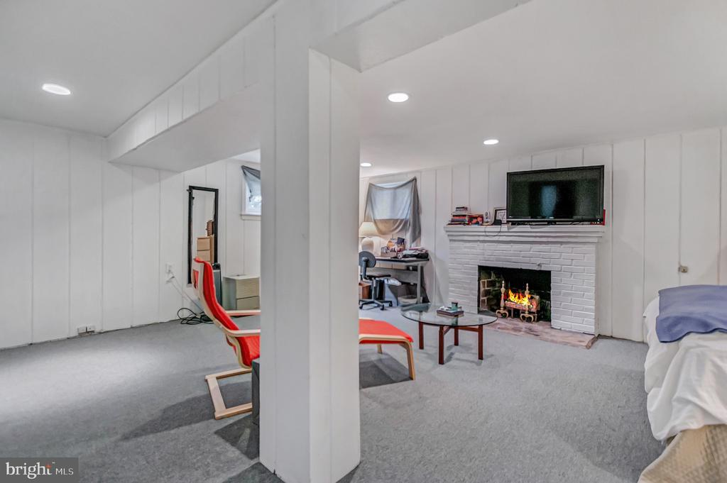 Family room has wood burning fireplace - 7007 CONNECTICUT AVE, CHEVY CHASE