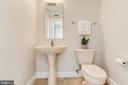 The half bath is located off the foyer - 1205 N GARFIELD ST #804, ARLINGTON