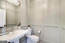 Paneled walls enhance the powder room - 4856 33RD RD N, ARLINGTON