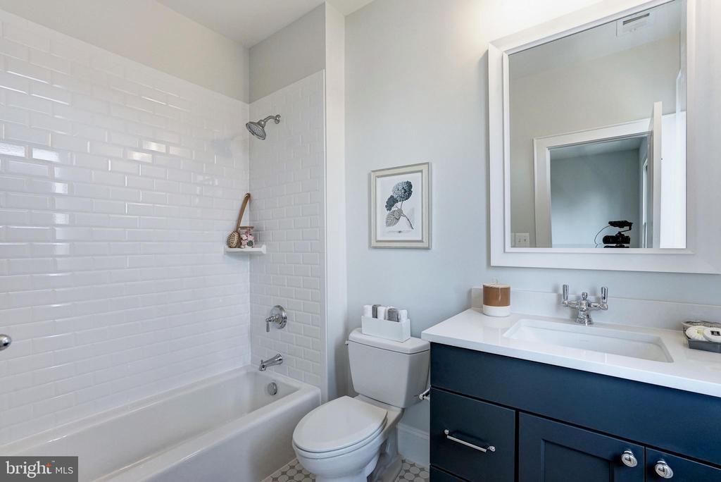 third upstairs bathroom with tub and vanity - 4856 33RD RD N, ARLINGTON