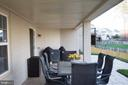 Covered rear patio off of the walkout family room - 26 WAGONEERS LN, STAFFORD
