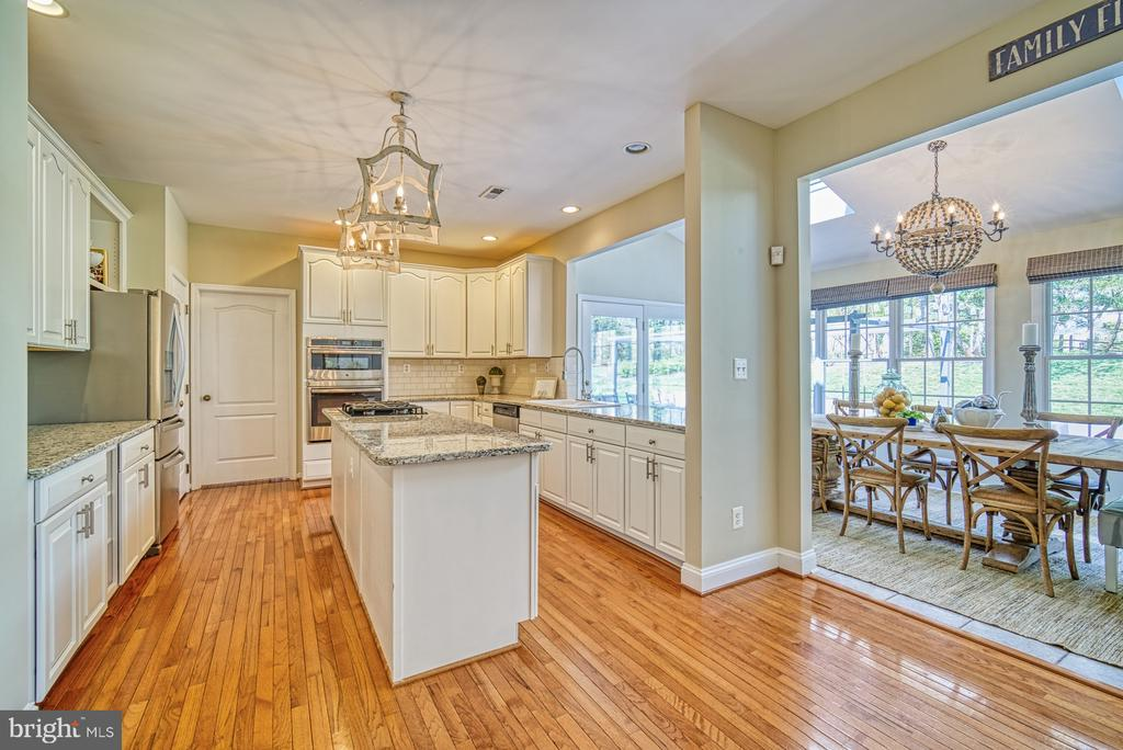 KITCHEN OPENS TO SUNROOM - 10896 HUNTER GATE WAY, RESTON