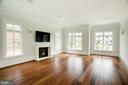 Adjoining family room with imported marble mantle - 3301 FESSENDEN ST NW, WASHINGTON