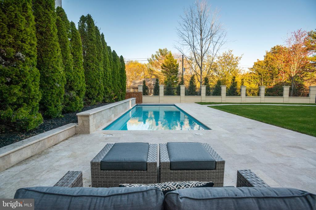 Pool waterfalls produce a calming ambience - 3301 FESSENDEN ST NW, WASHINGTON