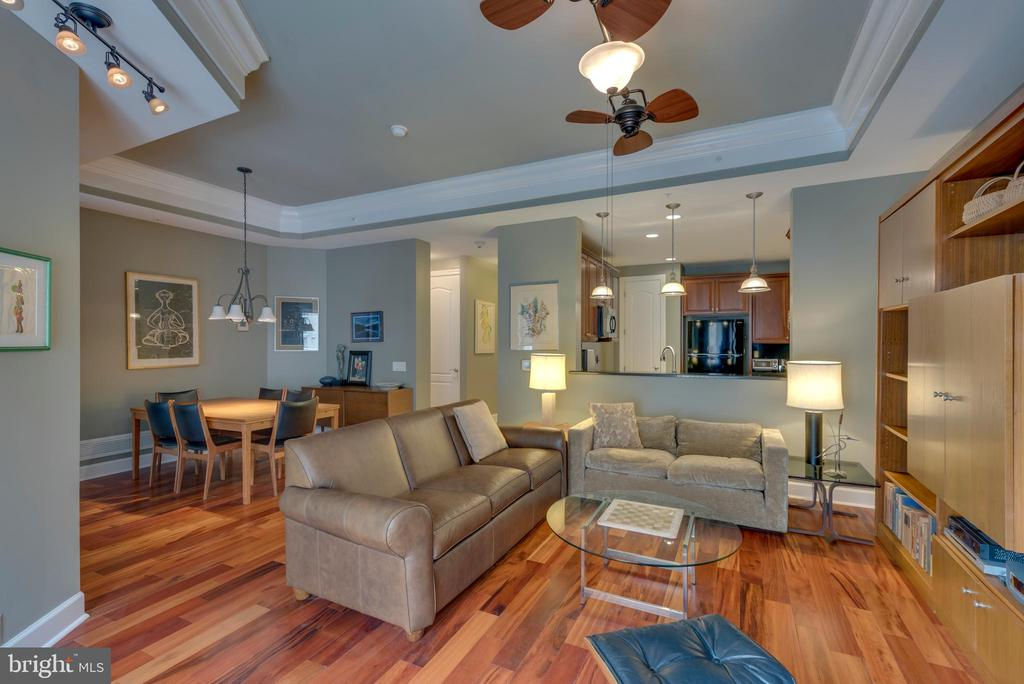 Gleaming hardwood floors in living, dining and den - 1915 TOWNE CENTRE BLVD #410, ANNAPOLIS