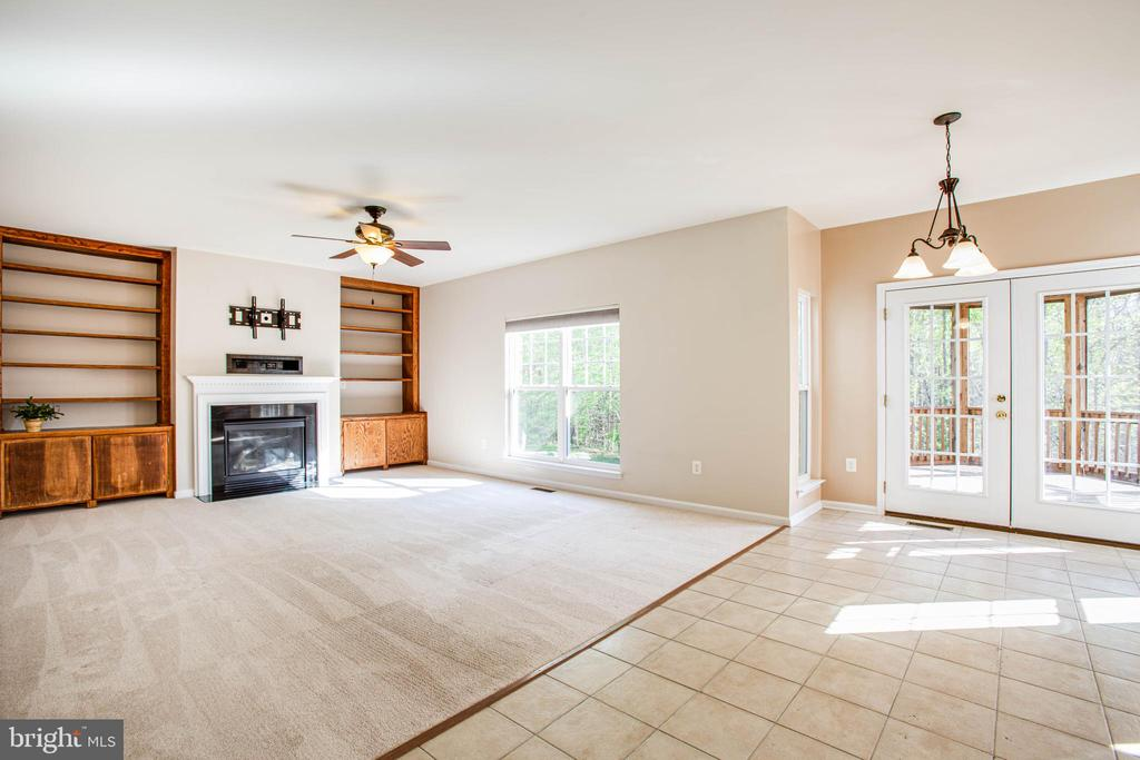 Large family room: gas fireplace, custom built-ins - 46 WILTSHIRE DR, STAFFORD
