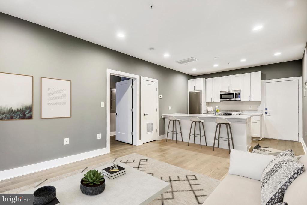Virtually staged living room - 1412 CHAPIN ST NW #203, WASHINGTON