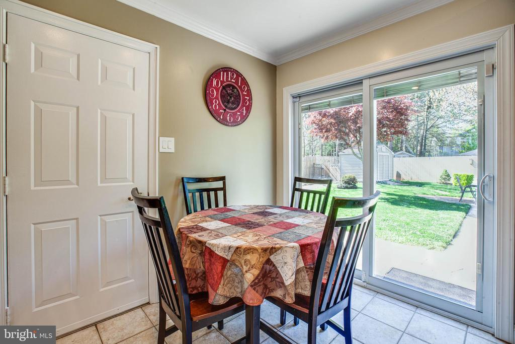 Breakfast nook looks out to incredible backyard - 6055 PONHILL DR, WOODBRIDGE