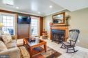Family room off kitchen has wood fireplace. - 6055 PONHILL DR, WOODBRIDGE