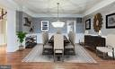 Formal dining room with upgraded glass chandelier - 18273 MULLFIELD VILLAGE TER, LEESBURG