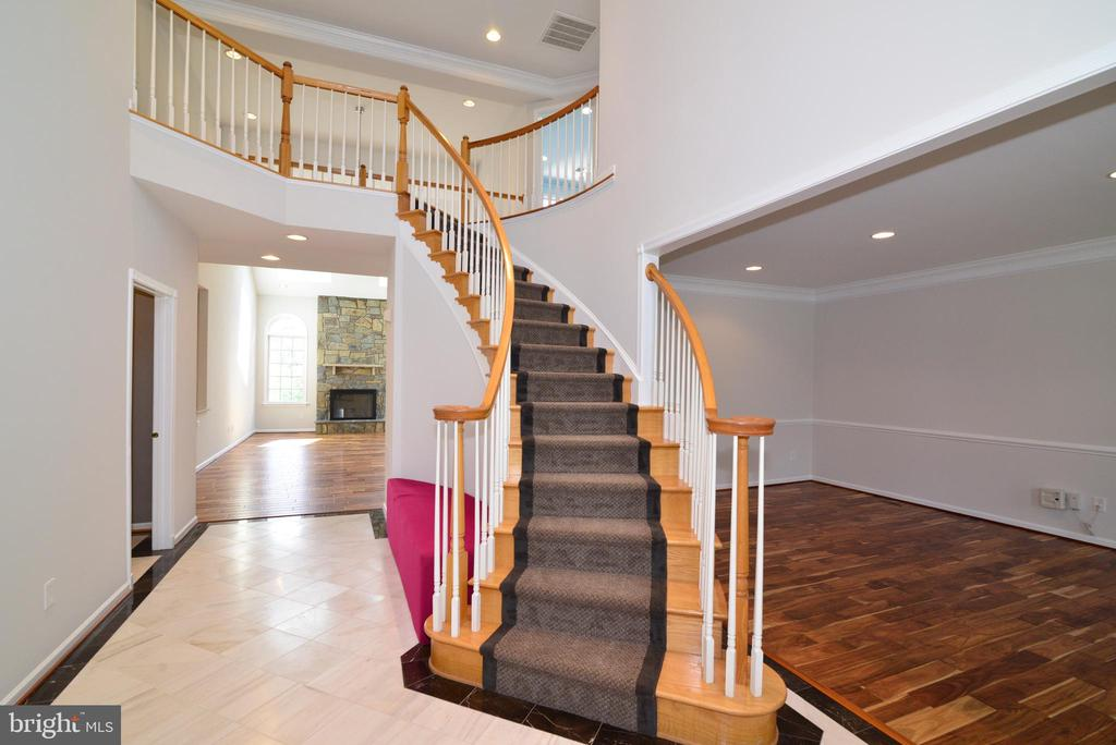 Grand Foyer with Curved Staircase - 13247 MIDDLETON FARM LN, HERNDON