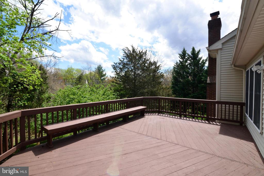 Spacious deck looking out on wooded HOA land - 13247 MIDDLETON FARM LN, HERNDON