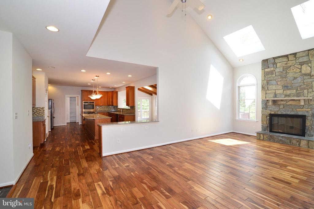 Family room with skylights and stone fireplace - 13247 MIDDLETON FARM LN, HERNDON