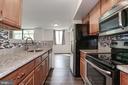 Galley kitchen with gorgeous backsplash - 1001 N VERMONT ST #310, ARLINGTON