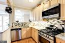 Stainless appliances throughout w/ gas range. - 4604 9TH ST NW, WASHINGTON