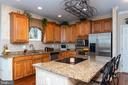 Chef's kitchen w/ granite & crown topped cabinetry - 8733 ENDLESS OCEAN WAY #32, COLUMBIA