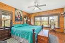 ONE OF TWO MASTER BEDROOMS ON THE MAIN LEVEL - 34876 PAXSON RD, ROUND HILL