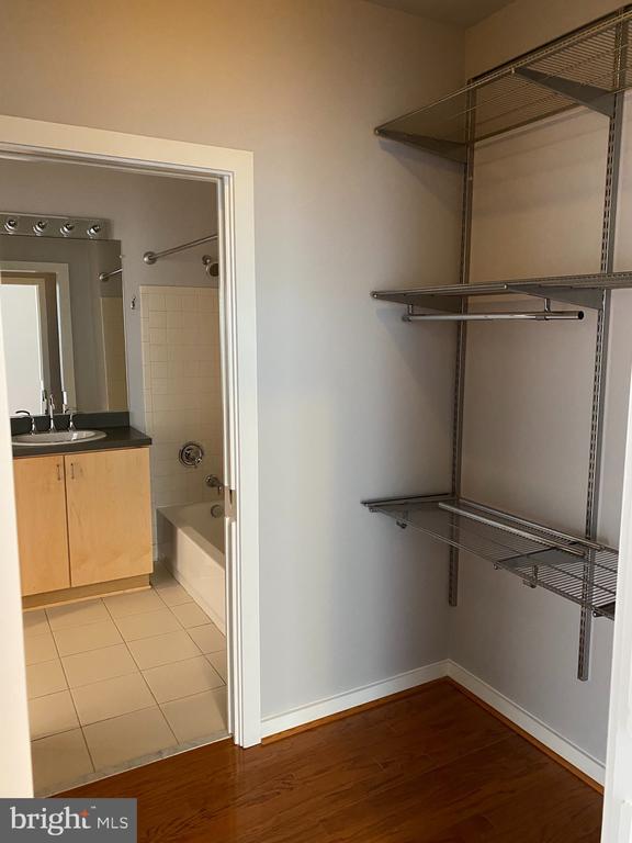 Closet with custom shelves - 1414 BELMONT ST NW #309, WASHINGTON
