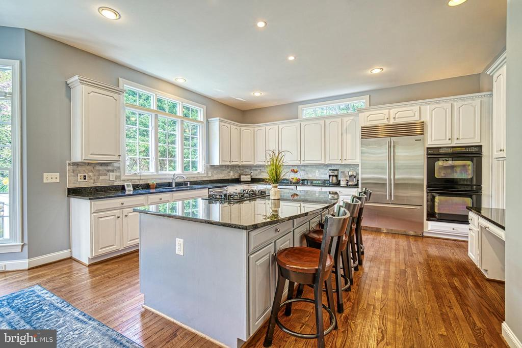A huge island for multiple seating and food prep! - 2704 SILKWOOD CT, OAKTON