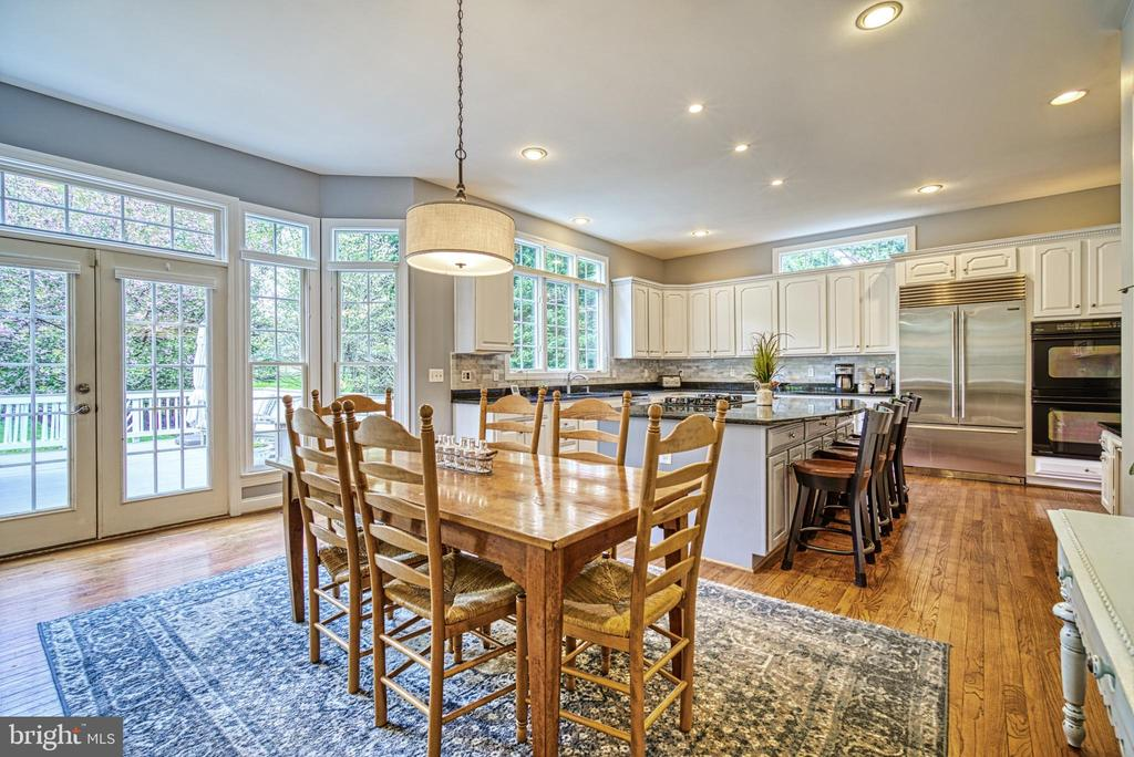 From the kitchen, double doors lead to your deck - 2704 SILKWOOD CT, OAKTON