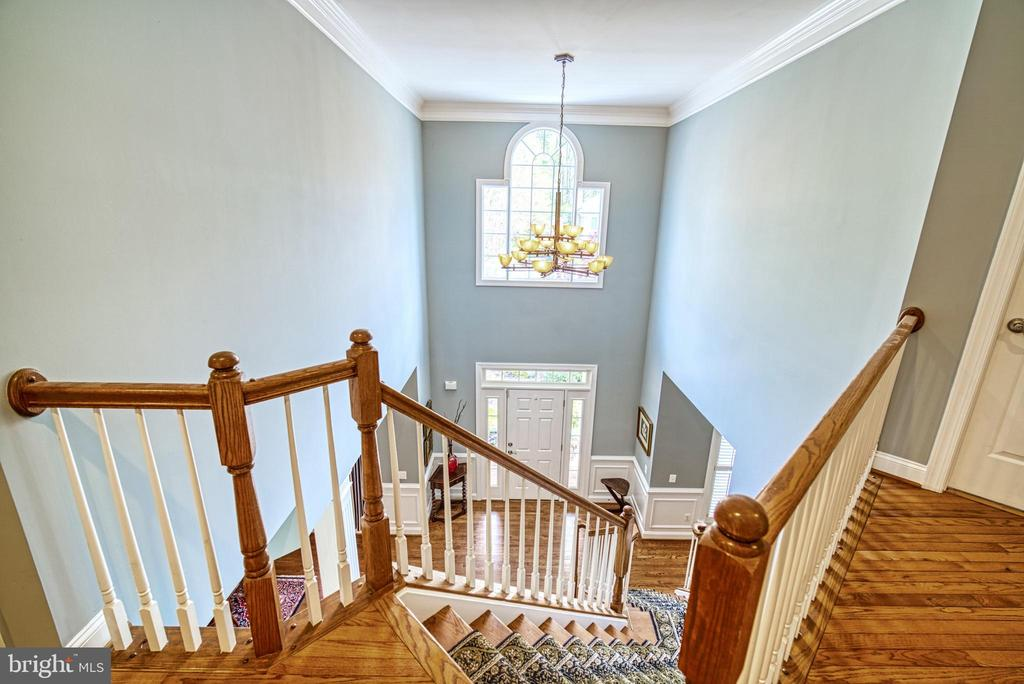 Foyer has cathedral ceiling and an open staircase - 2704 SILKWOOD CT, OAKTON