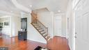 Entrance foyer with wood stairs - 31 CRAWFORD LN, STAFFORD