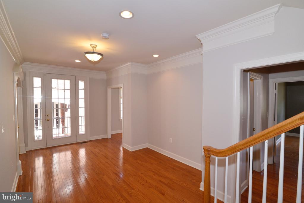 Foyer with Gleaming Hardwoods. - 18229 CYPRESS POINT TER, LEESBURG