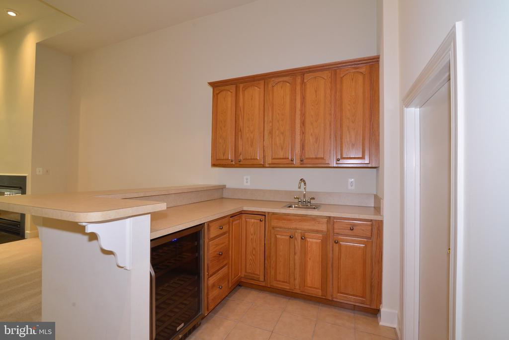 Lower Level Wet Bar with Beverage Refrigerator. - 18229 CYPRESS POINT TER, LEESBURG