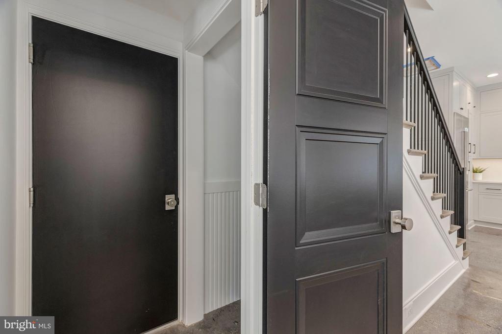 Main Level Powder Room and Garage Access - 17 FREDERICK DOUGLASS CT NE, WASHINGTON